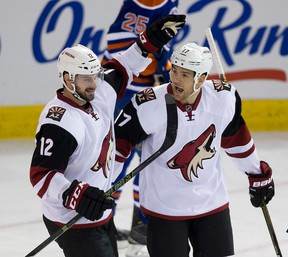 Coyotes' Steve Downie (right) celebrates his goal with teammate Brad Richardson (left) against the Oilers during first period NHL action in Edmonton on Jan. 2, 2015. (Greg Southam/Postmedia Network/Files)