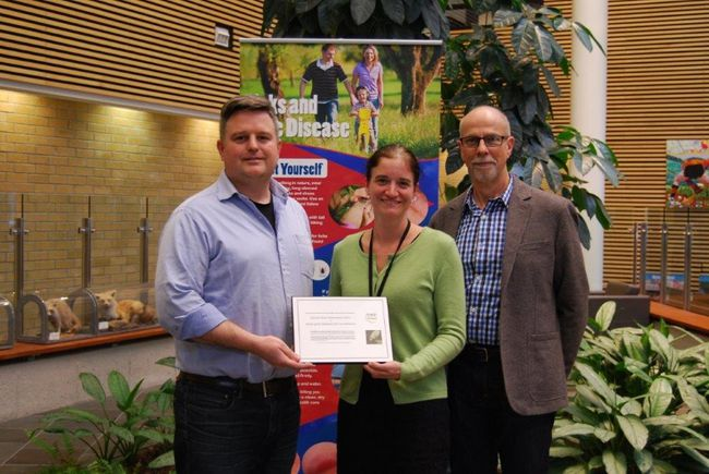 Veterinarian Dr. Michael Sloss, left, from Sunset Strip Veterinary clinic receives a plaque from Medical Officer of Health Dr. Christine Kennedy and public health manager Bob Hart in recognition of vet clinics across Grey-Bruce participating in an enhanced tick surveillance program. (Submitted photo and information)