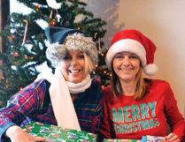 Marni Fedeyko, left, and Stephenie Shelstad prepare some of the gifts for deliver to the five families being supported in the annual Adopt a Family fundraiser that is part of Cochrane Light Up. The campaign was once again an overwhelming success.