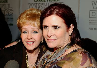 "Actresses Debbie Reynolds and Carrie Fisher arrive at the premiere of the HBO documentary ""Wishful Drinking"" at Linwood Dunn Theater at the Pickford Center for Motion Study on December 7, 2010 in Hollywood, California.  (Photo by Kevork Djansezian/Getty Images)"