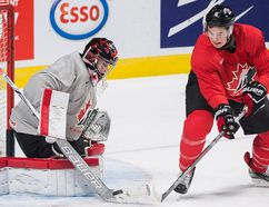 Graham Hughes/The Canadian Press Team Canada goaltender Carter Hart makes a save against teammate Julien Gauthier during practice Sunday, ahead of their quarter-final round match against the Czech Republic.