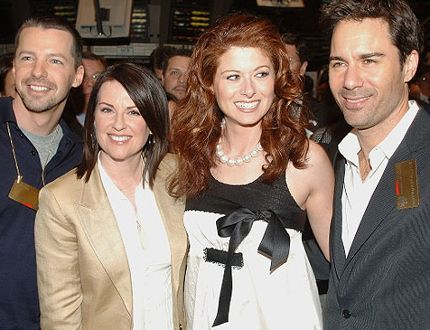 Sean Hayes, Megan Mullally, Debra Messing, and Eric McCormack from the Cast of 'Will and Grace' walk on the floor of the New York Stock Exchange on May 18, 2006 in New York City. (Photo by Brad Barket/Getty Images)