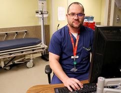 Luke Hendry/The Intelligencer Registered nurse Scott Simmons sits in a triage area of the Belleville General Hospital emergency department Tuesday. The holidays are a busy time for such departments and Quinte Health Care staff and doctors are asking patients to visit only in emergencies or when care isn't available from other providers.