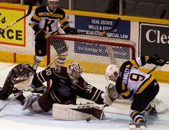 Kingston Frontenacs' Nathan Dunkley gets his stick caught behind the skate of Petes goalie Dylan Wells during an OHL game in Peterborough on Tuesday night. The Petes won 3-1. (Jessica Nyznik/Postmedia Network)