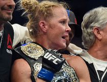Holly Holm holds the champion belt after defeating Ronda Rousey during their UFC 193 bantamweight title fight in Melbourne, Australia, Sunday, Nov. 15, 2015. Holm pulled off a stunning upset victory over Rousey in the fight, knocking out the women's banta
