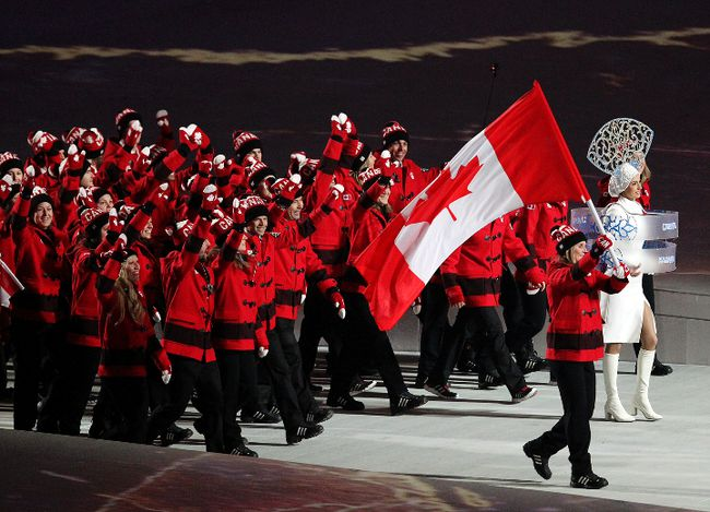 Team Canada women's hockey player and opening ceremonies flag-bearer Hayley Wickenheiser as well as other Canadian athletes walks into Olympic Stadium during the opening ceremonies of the Sochi 2014 Winter Olympics in Sochi, Russia, on Feb. 7, 2014. (Al Charest/Postmedia Network/Files)