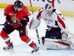 Senators forward Jean-Gabriel Pageau (44) looks on as the puck is deflected off of Capitals goalie Braden Holtby (70) during second period NHL action in Ottawa on Saturday, Jan. 7, 2017. (Fred Chartrand/The Canadian Press)