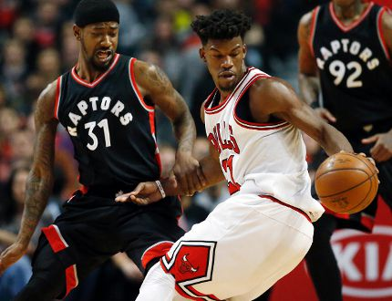Bulls guard/forward Jimmy Butler (right) controls the ball against Raptors forward/guard Terrence Ross (left) during first half NBA action in Chicago on Saturday, Jan. 7, 2017. (Nam Y. Huh/AP Photo)