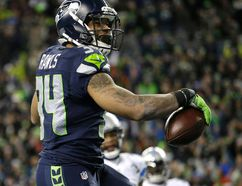 Seahawks running back Thomas Rawls celebrates after he rushed for a touchdown against the Lions during second half NFC wild card action in Seattle on Saturday, Jan. 7, 2017. (Elaine Thompson/AP Photo)