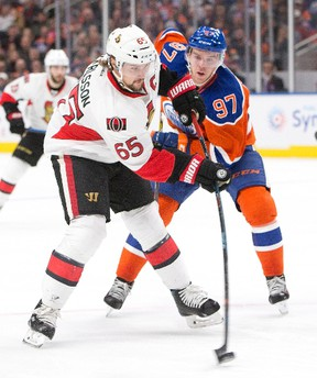 Senators' Erik Karlsson (65) gets the shot off as Oilers' Connor McDavid (97) gives chase during first period NHL action in Edmonton on Oct. 30, 2016. (Jason Franson/The Canadian Press)
