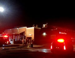 Kingston firefighters investigate a fire at Boston Pizza on Dalton Avenue in Kingston, Ont. on Saturday, Jan. 7, 2017. The fire was in the restaurant's main electrical room. No injuries were reported and the cause of the fire is being investigated. Damage is estimated at $15,000.