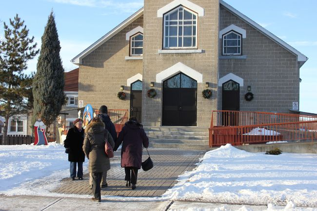 Families enter Ste-Croix Church for the last time on Saturday. The diocese of Alexandria-Cornwall announced the closure of the church immediately after Saturday's 4 p.m. mass. The parish will merge with St. Felix-de-Valois.