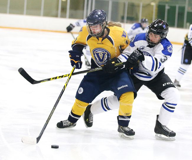Natasha Tymcio of the UOIT Ridgebacks battles for the puck with Taylor Philip of the Laurentian Voyageurs during OUA women's hockey action in Sudbury, Ont. on Sunday January 8, 2017. UOIT defeated Laurentian 6-5.Gino Donato/Sudbury Star/Postmedia Network