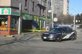 A police cruiser is pictured in the Queen-Sherbourne Sts. area where a man was shot and killed. (TERRY DAVIDSON, Toronto Sun)