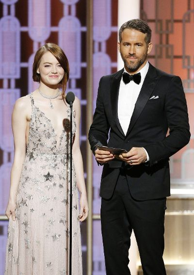 In this handout photo provided by NBCUniversal, presenters Emma Stone and Ryan Reynolds onstage during the 74th Annual Golden Globe Awards at The Beverly Hilton Hotel on January 8, 2017 in Beverly Hills, California. (Photo by Paul Drinkwater/NBCUniversal via Getty Images)