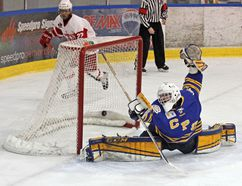 The one that got away. Carleton Place Canadian goalie Michael Leach butterflies but cannot prevent the Pembroke Lumber Kings from scoring on him for the second time in the first period during Sunday afternoon's game in the Pembroke Memorial Centre. In behind the net is Lumber King John D'Andre (22). It was his teammate Wesley Ashley who scored on the power play.
