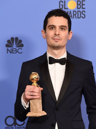 """Writer/director Damien Chazelle, winner of Best Screenplay for """"La La Land"""" poses in the press room during the 74th Annual Golden Globe Awards at The Beverly Hilton Hotel on January 8, 2017 in Beverly Hills, (California / AFP PHOTO / Valerie MACONVALERIE MACON/AFP/Getty Images)"""