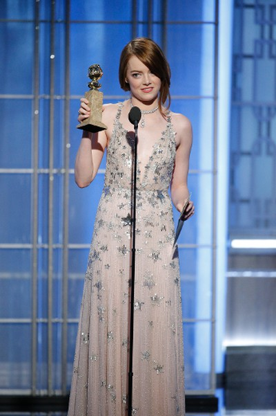 """This image released by NBC shows Emma Stone with the award for best actress in a motion picture comedy or musical for her role in """"La La Land"""" at the 74th Annual Golden Globe Awards at the Beverly Hilton Hotel in Beverly Hills, Calif., on Sunday, Jan. 8, 2017. (Paul Drinkwater/NBC via AP)"""