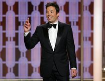 This image released by NBC shows host Jimmy Fallon at the 74th Annual Golden Globe Awards at the Beverly Hilton Hotel in Beverly Hills, Calif., on Sunday, Jan. 8, 2017. (Paul Drinkwater/NBC via AP)