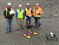 A crew from Hatch shows off some of the drone equipment used for water sampling in pit lakes. (Photo supplied)