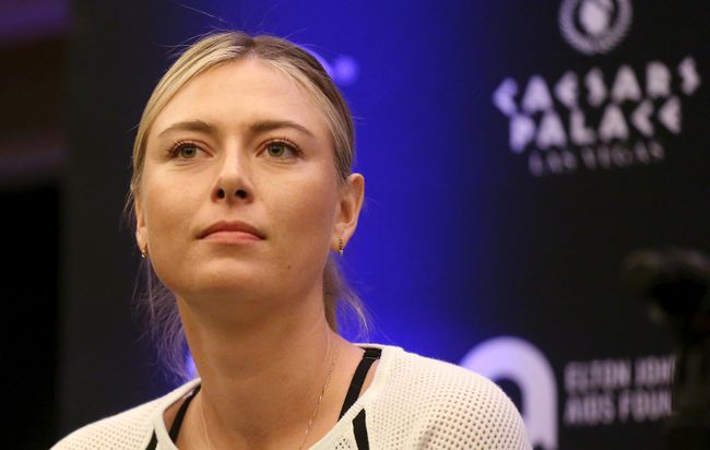 In this Monday, Oct. 10, 2016 file photo, Maria Sharapova speaks to members of the media prior to a World Team Tennis exhibition in Las Vegas. Sharapova will return from her 15-month doping ban at a tournament in Germany in April. (AP Photo/Isaac Brekken, file)