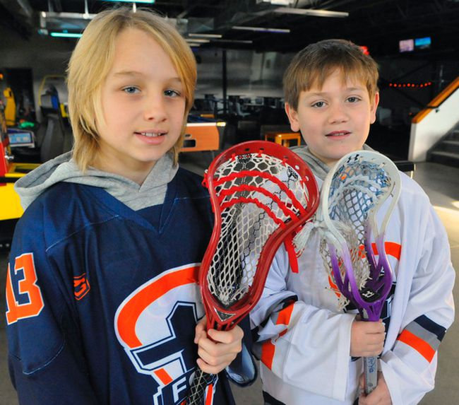 Jack Biro (left) and Jace Macaulay, both 10, have made an elite North American travel lacrosse team. The pair play for the Simcoe Timberwolves in the summer.