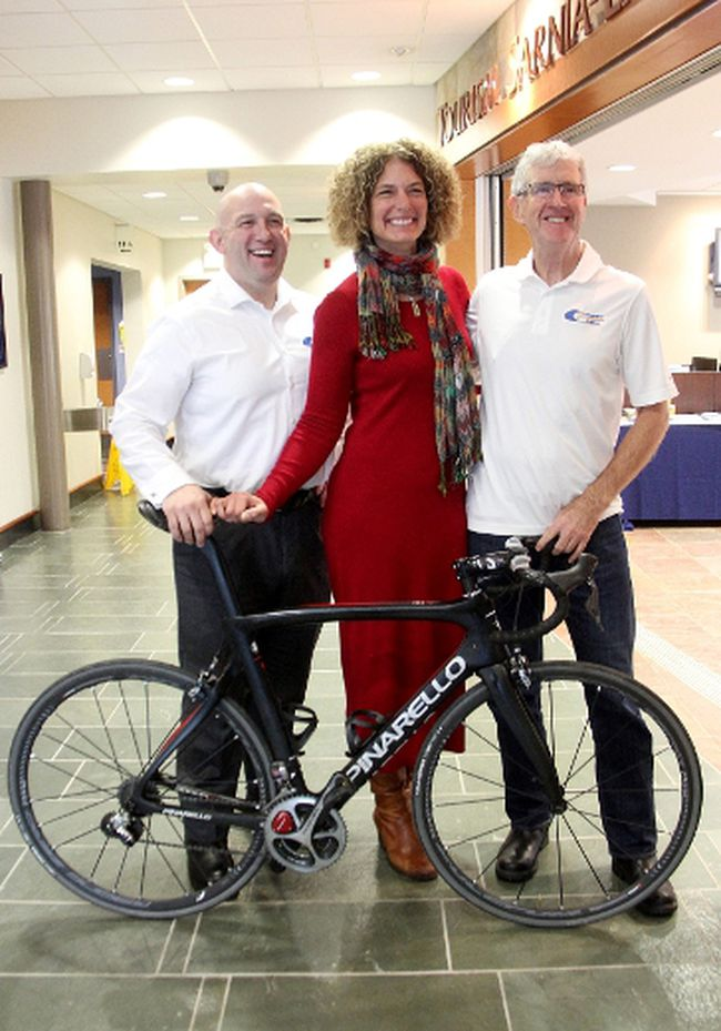 Jonathan Palumbo, left, Anita Trusler and Kenneth MacAlpine, with the Bluewater International Granfondo organizing committee, pose at the Tourism Sarnia-Lambton office in Point Edward Tuesday after announcing the second annual bike event is scheduled for Aug. 6. Organizers are hoping to attract 750 riders. Tyler Kula/Sarnia Observer/Postmedia Network
