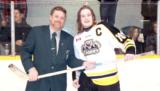 Sarnia Silver Stick tournament director Mark Colbran presents Aurora Tigers captain Greg Martin with a replica Silver Stick after his club won the midget AA championship at Clearwater Arena two years ago. The 48th annual Sarnia Silver Stick boy's atom and midget international finals returns this weekend. (Terry Bridge/Sarnia Observer/Postmedia Network)