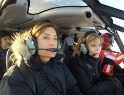 Actress and environmentalist Jane Fonda, centre, flanked by Canadian actress Barbara Williams and Paul Spring of Phoenix Heli-Flight, during an aerial tour of the oilsands on Tuesday, January 10, 2016. Supplied Image/Mike Hudema/Greenpeace Canada