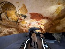 People visit the new replica of the Lascaux cave paintings during the first public opening on December 15, 2016 in Montignac, in the Dordogne region of southwest France, more than seven decades after the prehistoric art was first discovered. / AFP / MEHDI FEDOUACH (Photo credit should read MEHDI FEDOUACH/AFP/Getty Images)