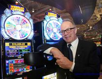 Andy LaCroix, executive director of stakeholder relations in Ontario with Great with Canadian Gaming Corporation leans against some of the machines during the opening celebration of Shorelines Casino, on Wednesday January 11, 2017 in Belleville, Ont. Emily Mountney-Lessard/Belleville Intelligencer/Postmedia Network