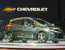 A man takes a photo of the Chevrolet Bolt at the 2017 North American International Auto Show in Detroit, Michigan, January 10, 2017. (GEOFF ROBINS/AFP/Getty Images)