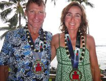 Submitted photo: Tony Biernacki and Kristen Bridges show off their medals from the Ironman World Championships in Hawaii last October.