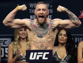 Boxer Floyd Mayweather made a $15 million US offer to Conor McGregor to step in the ring and not the octagon. (Julio Cortez/AP Photo/Files)
