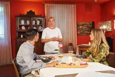 """This Sept 2016 photo provided by the Slovenia Tourist Board shows chef Ana Ros, standing center, greeting guests at Hisa Franko, in the remote village of Kobarid, in the western part of Slovenia. Ros, who starred last year in an episode of the Netflix series """"Chef's Table,"""" heads the kitchen and her husband Valter Kramar is the resident cheese and wine expert at the inn and restaurant on the small farm he inherited from his father. (Slovenia Tourist Board via AP)"""