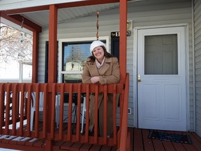 In this undated photo provided by Kodi Bryant, Bryant stands on the front porch of her trailer home in Golden, Colo. (Nathan Shafer/Kodi Bryant via AP)