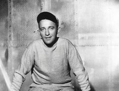 """Bing Crosby takes a break between scenes of the film """"Going My Way"""" (1944), for which he won the Oscar for best actor in a leading role. (Bing Crosby Enterprises/Associated Press)"""