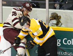 Kingston Frontenacs' Ted Nichol, right, collides with the Petes' Josh Coyle along the boards during OHL action Nov. 3, 2016, at the Memorial Centre in Peterborough. (Clifford Skarstedt/Postmedia Network)