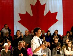 With the Maple Leaf in the background, Prime Minister Justin Trudeau speaks during a town hall meeting attended by approximately 265 people in Memorial Hall at City Hall on Thursday. (Ian MacAlpine/The Whig-Standard)