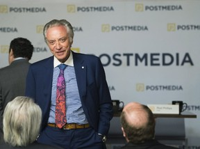 Postmedia CEO Paul Godfrey speaks with people during the company's annual general meeting in Toronto on Jan. 12, 2017. (THE CANADIAN PRESS)