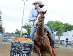 Joanie Rouleau rounds the first barrel during her RAM Rodeo Tour's barrel racing event at the Beachburg Fair last July.