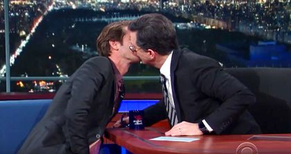 Colbert and Garfield smooch