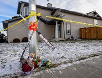 A memorial was set up in front of the house on Haney Court where Ryder and Radek were murdered on Dec. 19, 2016. File photo