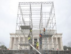 Construction workers climb scaffolding erected for the presidential inauguration in Washington, D.C. on Friday. (ANDREW CABALLERO-REYNOLDS/AFP/Getty Images)