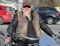 "It was a cold winter day Friday but that didn't stop Glen ""Mad Dawg"" Edwards, a member of the Brantford Iron Hawgs, from riding his motorcycle to Port Dover for the town's latest Friday the 13th motorcycle rally. Edwards, of Brantford, was cold and stiff when he arrived but ready to party. MONTE SONNENBERG/SIMCOE REFORMER"