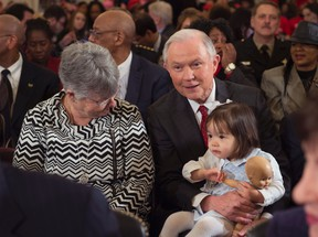 Sen. Jeff Sessions, centre, sits next to his wife Mary and their granddaughter, prior to the Senate Judiciary Committee hearings on Sessions' nomination to be Attorney General on January 10, 2017 in Washington, D.C. (MOLLY RILEY/AFP/Getty Images)