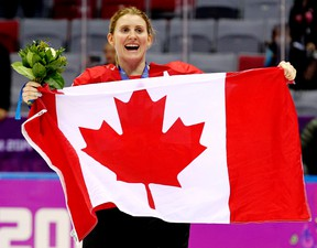 Team Canada's Hayley Wickenheiser celebrates with a Canadian flag after beating Team USA 3-2 in overtime to win the women's ice hockey gold medal at the Bolshoy Ice Dome during the Sochi Winter Olympics in Sochi, Russia, on Feb. 20, 2014. Wickenheiser announced her retirement from the national team on Friday, Jan. 13, 2017. (Al Charest/Postmedia Network/Files)
