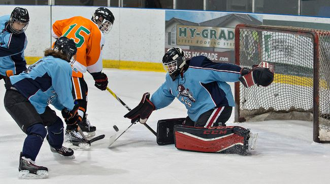 Jacob Smith (15) of North Park Collegiate watches as Assumption College goalie Dan Murphy blocks his shot during a high school boys hockey game at the Wayne Gretzky Sports Centre. (Brian Thompson/The Expositor)