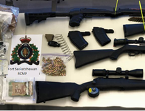 Fort Saskatchewan RCMP seized drugs, guns and cash during a search of two homes and two storage lockers Dec. 15, 2016. (Supplied photo)