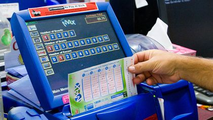 Lotto Max ticket being sold